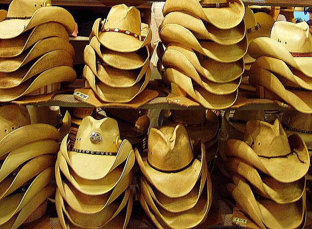 Cowboy hats – Picture courtesy Wiki Commons.