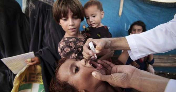 Polio drops are administered at camp in Jalozai. – File photo by AP