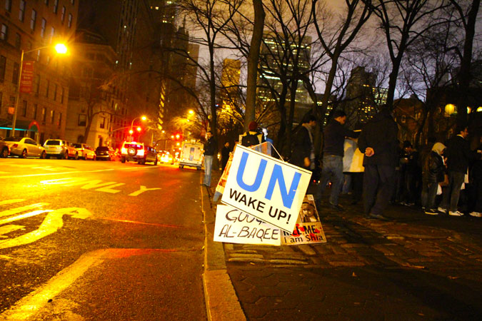 Picture shows a protest placard that demands effort from the UN to act against the bombings. The protest took place in New York City. - Photo by Sadef Ali Kully/Dawn.com