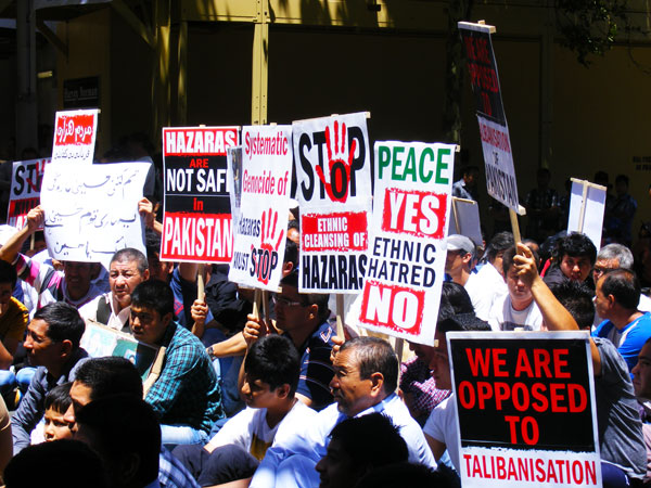 Protesters outside the Pakistani Consulate Office demand the Consulate General to come out from his office and speak. ?Photo by Sarwat Hassan for Dawn.com