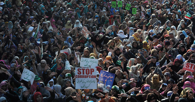 Supporters of Pakistani cleric Tahir-ul Qadri gather at a protest rally in Islamabad on January 15, 2013.