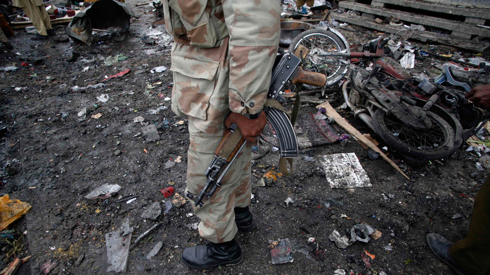 A paramilitary soldier stands at the scene of the bomb explosion.