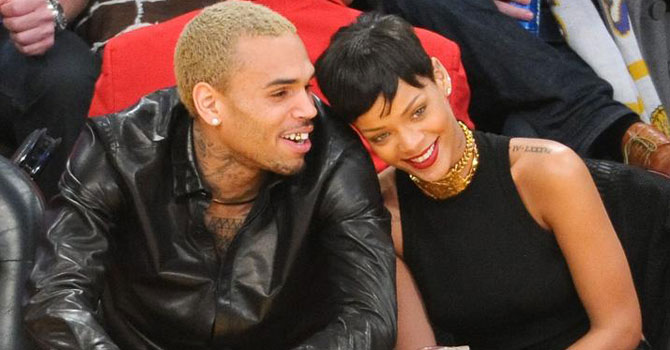 Chris Brown and Rihanna attend a basketball game on December 25, 2012 in Los Angeles, California. —Photo (File) AFP
