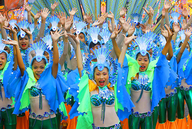 "Students perform in a street dance competition during the 15th Sikhyana festival in Santa Rosa city, Laguna province, south of Manila. Locals celebrate the Sikhayan festival, a contraction of Filipino words ""Sikhay"" meaning diligence and ""Kabuhayan"" for livelihood, to recognize the spirit of enterprise, ingenuity and craftmanship of their people.?Photo by Reuters"