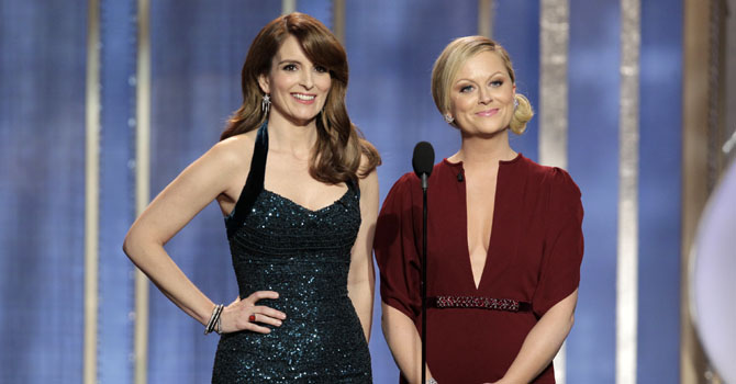 This image released by NBC shows co-host Tina Fey, left, and Amy Poehler on stage during the 70th Annual Golden Globe Awards held at the Beverly Hilton Hotel on Sunday, Jan. 13, 2013, in Beverly Hills, Calif. - Photo by AP