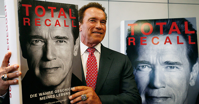 Actor and former California governor Arnold Schwarzenegger presents his book 'Total Recall' during a news conference during the book fair in Frankfurt, in this October 10, 2012 file photo. A year after leaving the California governor's office and becoming tabloid fodder for fathering a boy with his family's housekeeper and splitting with his wife, Maria Shriver, the 65-year old former bodybuilder will star in no less than three Hollywood movies over the next 12 monthsREUTERS/Ralph Orlowski/Files (GERMANY - Tags: MEDIA BUSINESS ENTERTAINMENT)