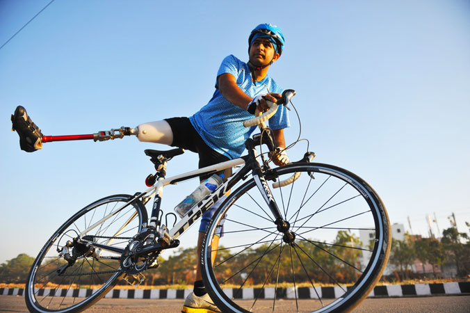 Indian disabled cyclist Aditya Mehta, prepares to ride during a practise session in Hyderabad. Mehta lost his right leg in a bus accident seven years ago, and with the support of family and friends, he took up cycling few months ago. Mehta will represent India in cycling during the 2013 Asian Para Games on March 7 which is being held in New Delhi.  ?Photo by AFP