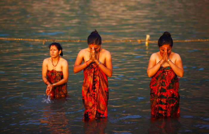 Nepalese devotees at Devghat take holy dip in Narayani river during Maghe Sankranti. Makar Sankranti is also termed the festival of Sun God. Devotees think that the Sun God is a symbol of power, divinity and wisdom. ?Photo by AP