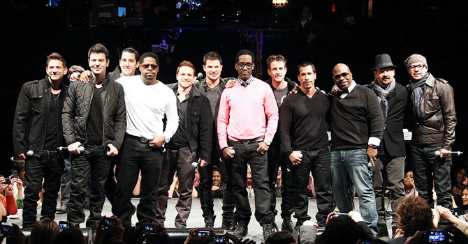 This picture provided by Starpix shows members of 98 Degrees, Boyz II Men, and New Kids on the Block, during the announcement of 'The Package Tour' featuring the three bands. —Photo by AP