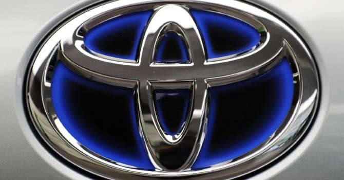This file photo taken on Aug 2, 2011, shows a Toyota Motors logo displayed at their Tokyo headquarters. Toyota and Nissan on Jan 28, 2013 posted record sales for 2012 as the Japanese car giants benefited from a pick-up in demand, with Toyota recapturing the world's biggest automaker crown from General Motors.  - AFP Photo