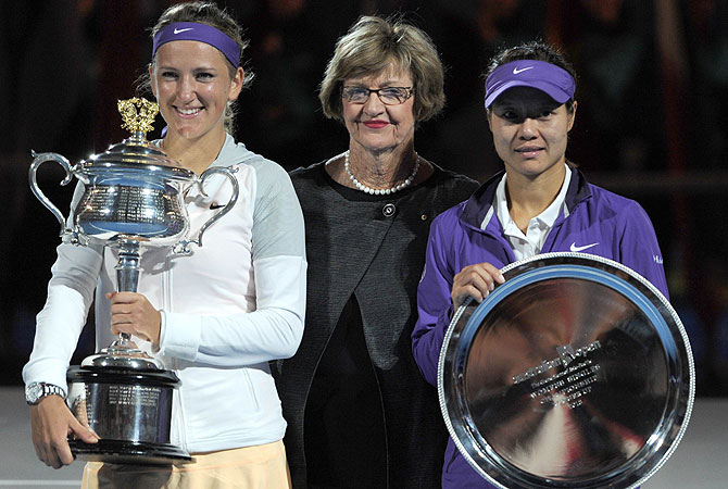 Belarus's Victoria Azarenka (L) poses with former champion Margaret Court (C) and runner-up Li Na of China (R). -Photo by AFP