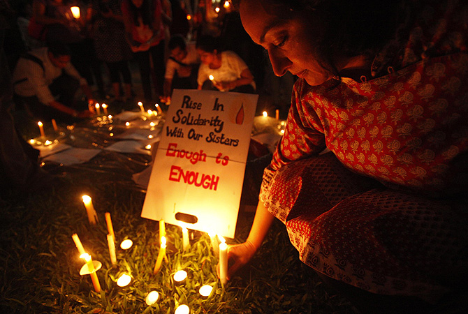 A participant leaves a candle next to a sign during a candlelight vigil for the Indian rape victim, who passed away last Friday, in Singapore. The death of the 23-year-old woman, who has not been named, prompted street protests across India, international outrage and promises from the government of tougher punishments for offenders. About 150 people took part in the vigil in Singapore.—Photo by Reuters