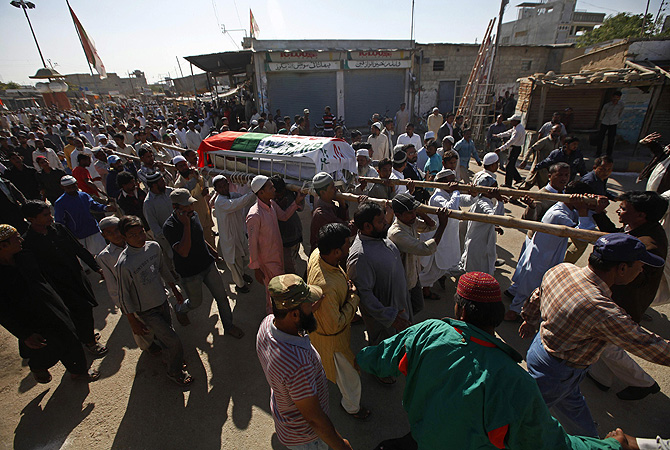 People carry the coffin of Taiyab Hussain, who was killed in Tuesday's motorcycle bomb blast, during his funeral in Karachi. A bomb exploded in a crowded area of Pakistan's southern port city of Karachi on Tuesday, killing at least two people and wounding 50, police said.—Photo by Reuters