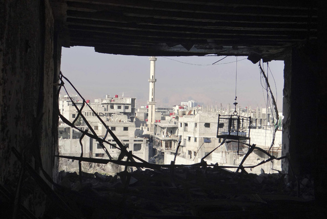 View of buildings damaged by what activists said were shelling by Syrian force loyal to President Bashar al-Assad in Erbeen, near Damascus.—Photo by Reuters