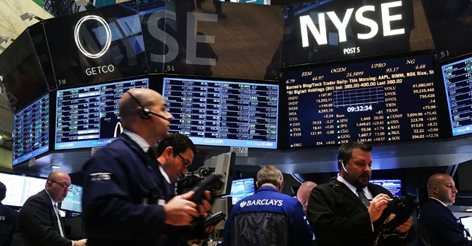 Traders work on the floor of the New York Stock Exchange on Jan 2, 2013 in New York City. A day after US lawmakers reached a last minute agreement to avert the fiscal cliff, US stocks surged as traders around the globe felt renewed confidence over global markets. Shortly after the opening bell, The Dow Jones Industrial Average rallied more than 230 points, or 1.7 per cent. - AFP Photo/File