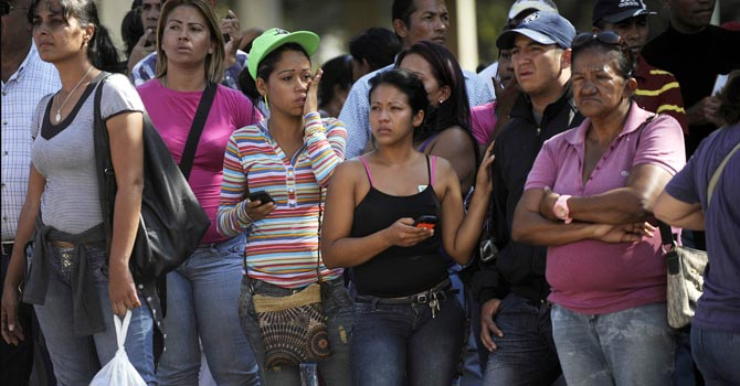 Relatives of deceased inmates wait outside of a morgue a day after a riot broke out at the Uribana prison in Lara state, Venezuela, in Jan 26, 2012. At least 55 people were killed and 90 others wounded in clashes between prison gangs and security guards at a facility in northwest Venezuela, a hospital director said Saturday. - AFP Photo
