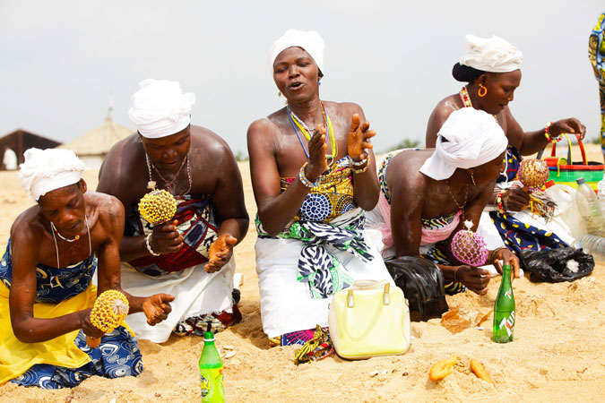 Voodoo worshippers make sacrifice at the beach.