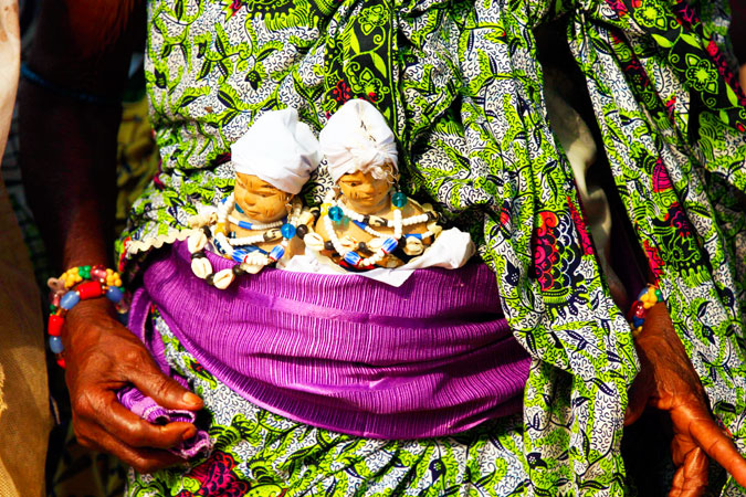 Voodoo dolls wrapped into a woman's dress during the festival.
