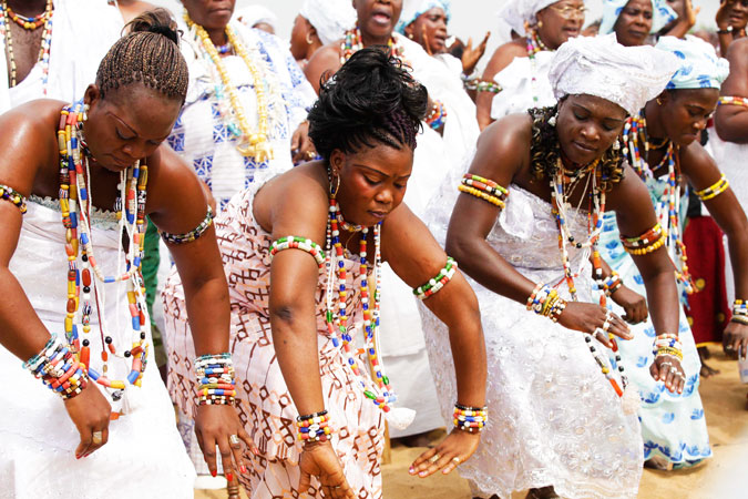 Voodoo worshippers dance during the festival.