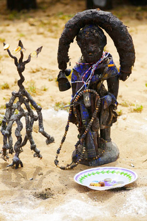 A voodoo effigy on display.