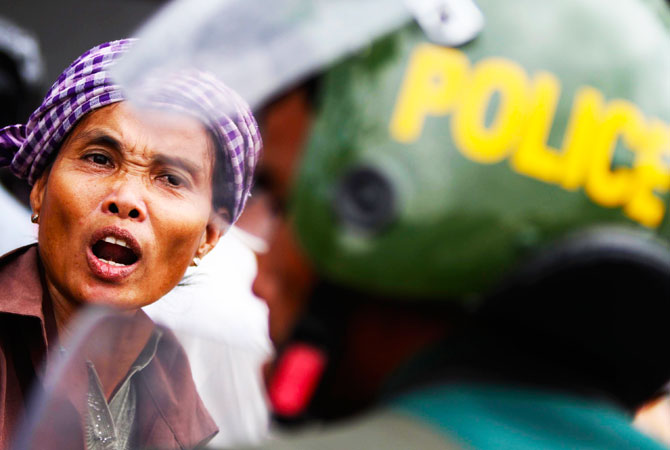 Woman reacts during a protest in front of the Peace Palace in Phnom Penh. Boeung Kak lake residents, embroiled in land disputes in the capital, gathered to appeal to Cambodian Prime Minister Hun Sen for help regarding the threatened eviction from their land to be used for the development of luxury private property. -Photo by Reuters