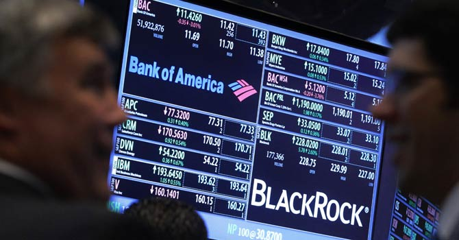 A screen displays the trading price for Bank of America and Black Rock stocks on the floor of the New York Stock Exchange, Jan 17, 2013. - Reuters