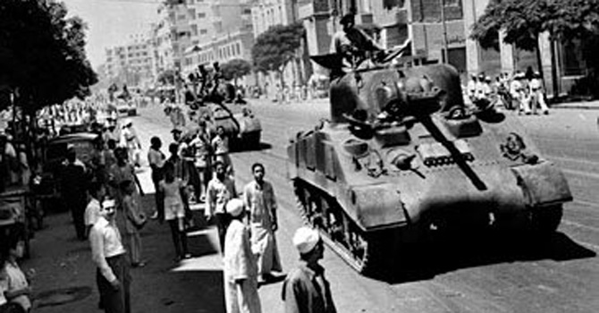 Egyptian army tanks move in on the roads of Cairo during the 1952 Free Officers' coup.