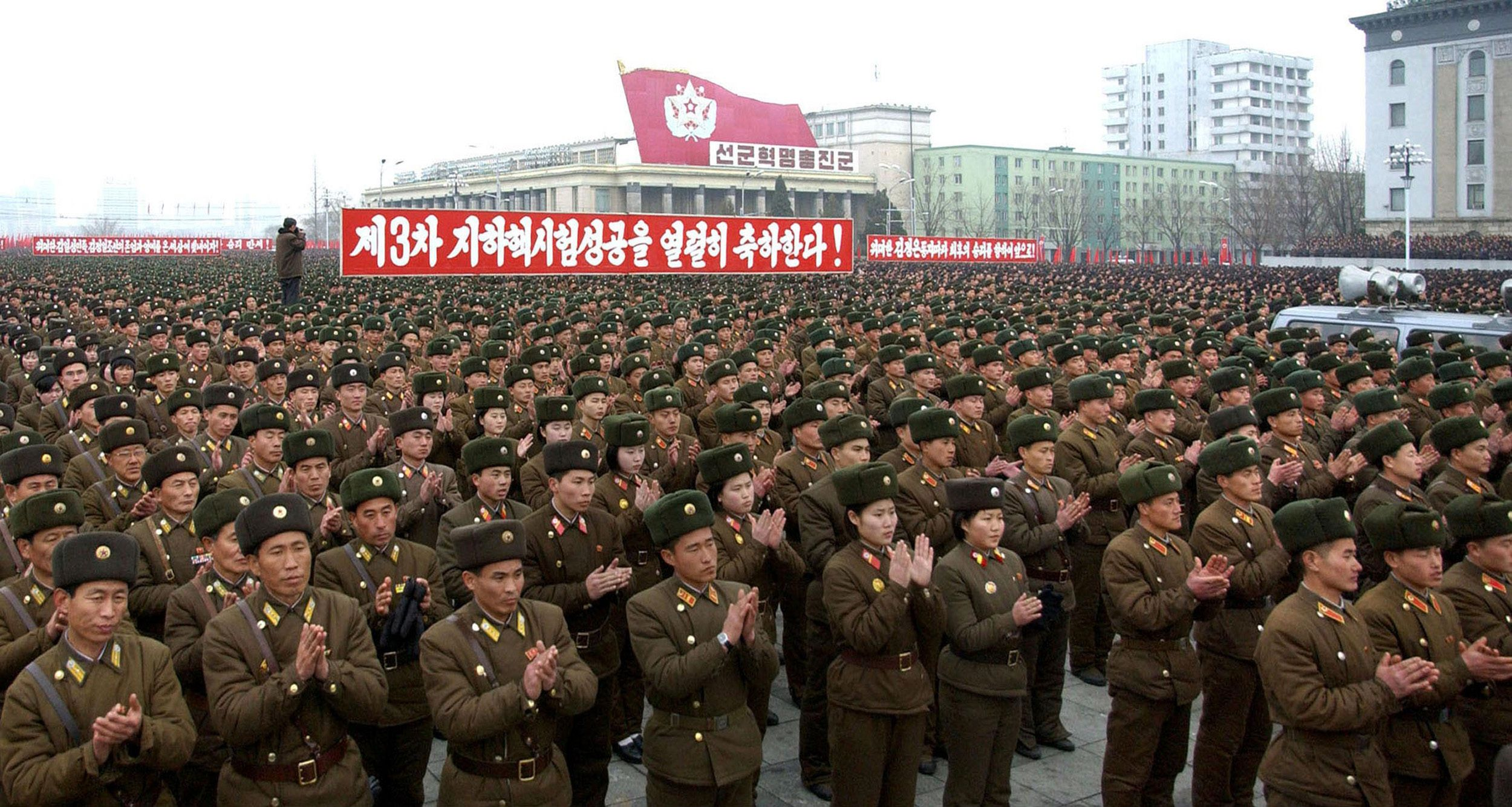 This picture, taken on North Korea's official Korean Central News Agency on February 14, 2013 shows army servicepersons holding a rally to celebrate the successful third underground nuclear test at the Kim Il Sung Square in Pyongyang. Senior officials of the party, state and army, service personnel of the Korean People's Army joined the rally.   AFP Photo / KCNA via KNS