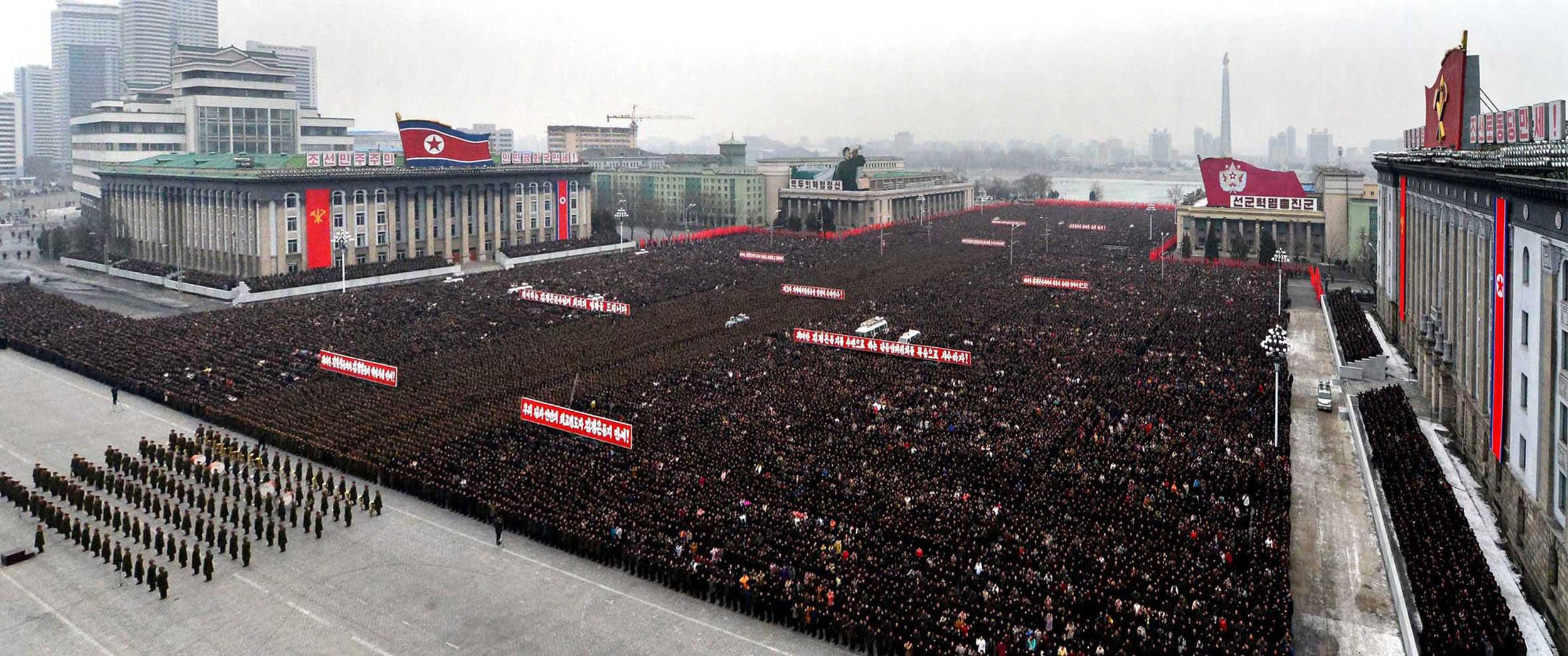 This picture, taken on North Korea's official Korean Central News Agency on February 14, 2013 shows people holding a rally to celebrate the successful third underground nuclear test at the Kim Il Sung Square in Pyongyang. Senior officials of the party, state and army, service personnel of the Korean People's Army joined the rally.   AFP Photo / KCNA via KNS
