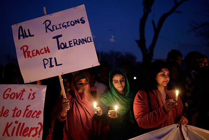Pakistanis hold candles during a protest condemning the bombing attack that took place in Quetta last Saturday, in Islamabad, Pakistan, Monday, Feb. 18, 2013. The families of scores of victims of the bombing in Quetta have refused to bury their relatives until authorities take action against the militants who were responsible. ? AP Photo