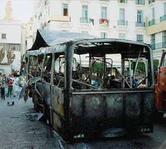 Wreckage of a government bus that was torched by protesters during the anti-government riots in Algeria in 1988. The riots confirmed the collapse of Algerian socialism.