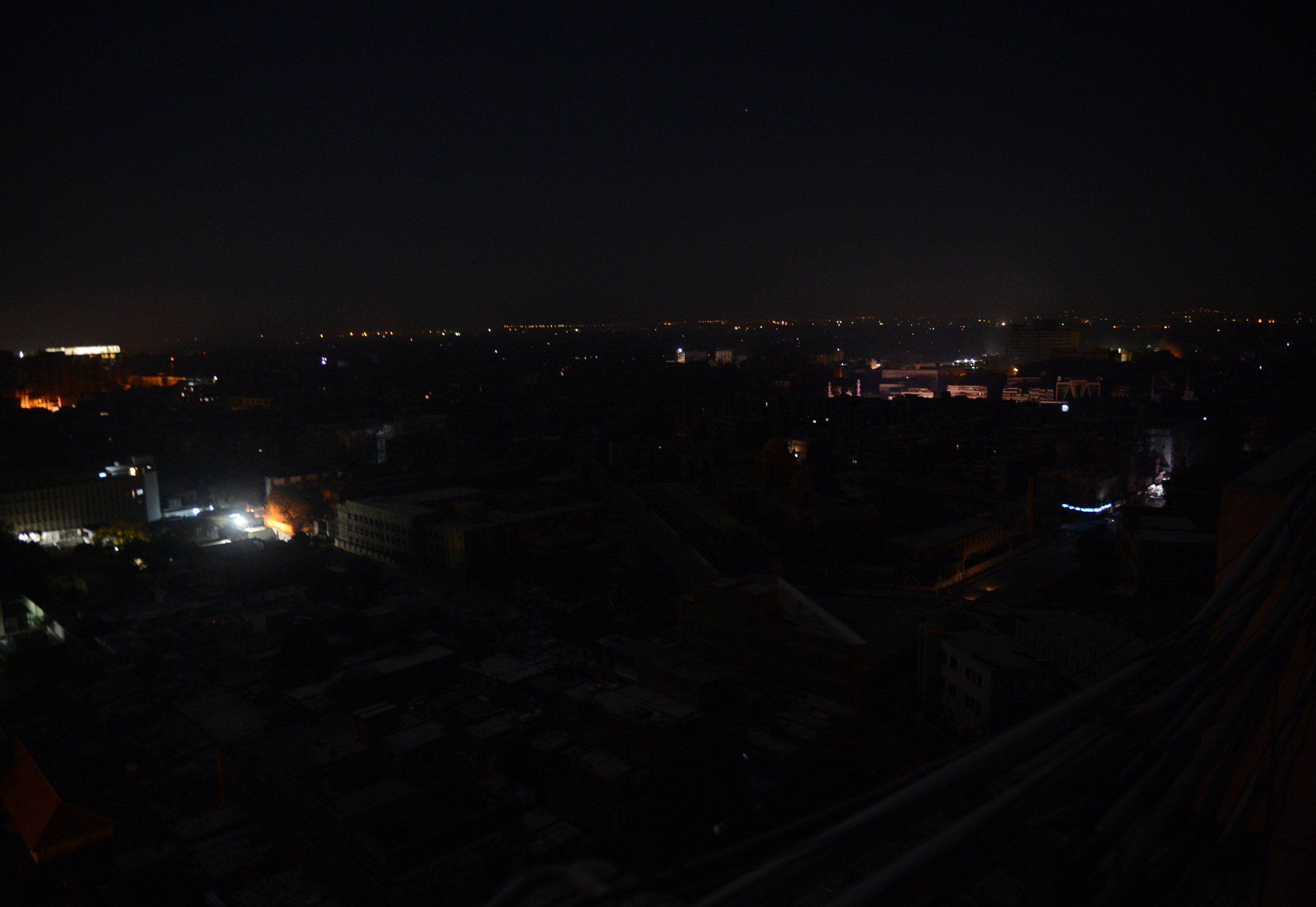 This picture taken on February 24, 2013 shows an aerial view of buildings and homes during a nationwide power blackout in Karachi. Pakistan was hit by a nationwide blackout for more than two hours after the breakdown of a major plant caused power stations to stop working across the country, officials said on February 25.  ? AFP Photo