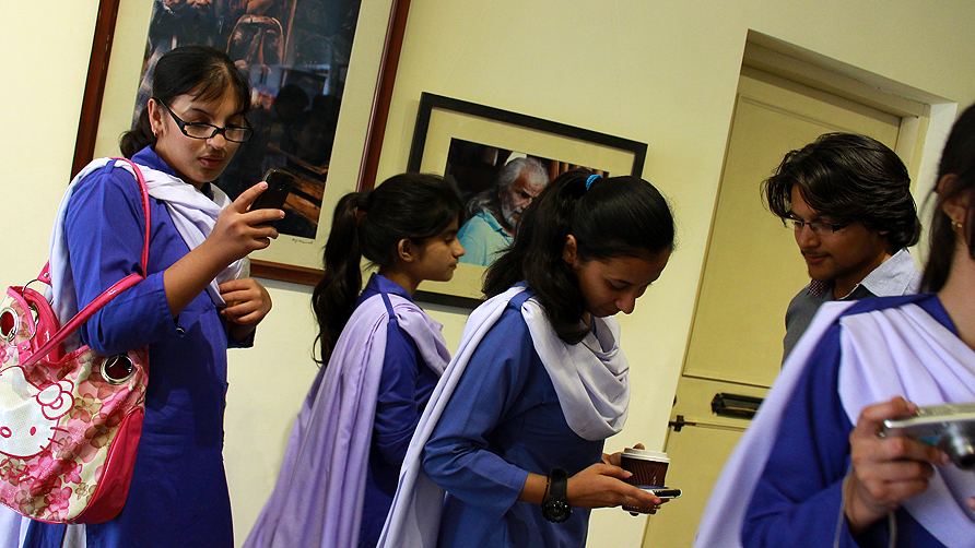 Girls from The Educators at the Tapu Javeri and Arif Mahmood photography exhibit. -Photo by Shameen Khan/Dawn.com