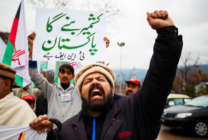A Pakistani Shia Muslim shouts slogans while taking part in a rally to mark Kashmir Solidarity Day in Islamabad. The placard reads in Urdu: ?Kashmir to become a part of Pakistan?.