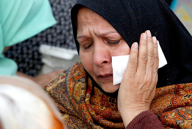 A Shia Muslim woman cries during a protest against Saturday's bombing, in Lahore February 18, 2013. ? Reuters Photo