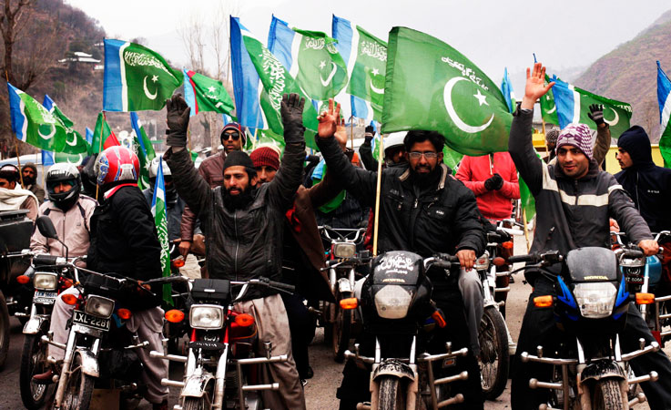 Supporters of the political and religious party Jamaat-i-Islami (JI) take part in a rally to mark Kashmir Solidarity Day.
