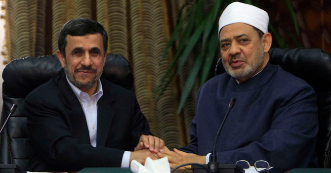 Iran's President Mahmoud Ahmadinejad (L) shakes hands with Al-Azhar's Grand Sheikh Ahmed al-Tayeb during their meeting in Cairo February 5, 2013. -Reuters Photo