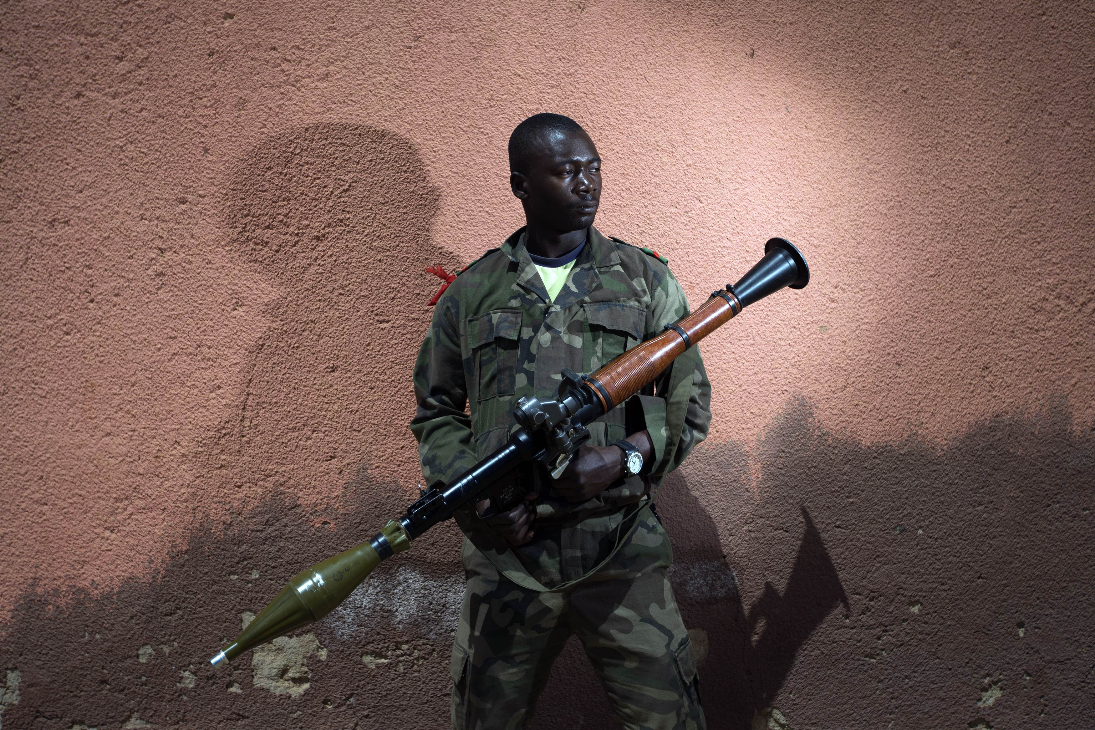 Malian army soldier Lassine Traore, aged 24, holds a  bazooka in Gao, some 1,200 kilometres north of Bamako. After recapturing the north's cities from the Al Qaeda groups that had controlled them since April 2012, the six-week-long French-led offensive took the fight to the retreating Islamist insurgents' toughest desert bastions.?Photo by AFP