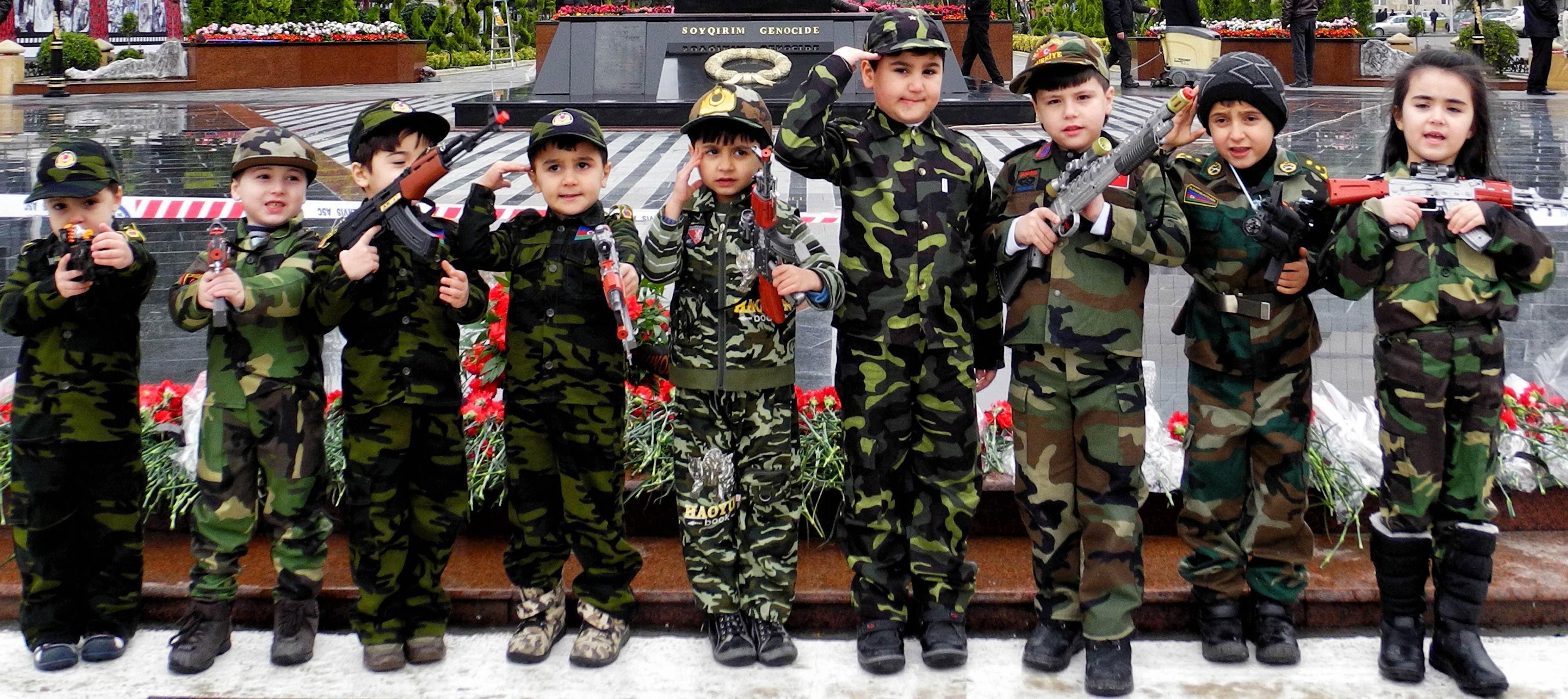 "Wearing army-style camouflage costumes little Azerbaijanis take part in a ceremony to mark the 21st anniversary of what Azerbaijan refers to as the ""Khojaly Massacre"" at a monument to the Khojaly  victims in Baku, the capital of Azerbaijan. Azerbaijani authorities say 613 people died when Armenian troops attacked the village of Khojaly in Karabakh in 1992 during Nagorny-Karabakh conflict in what Baku has described as ""genocide"", a term fiercely rejected by Yerevan.?Photo by AFP"