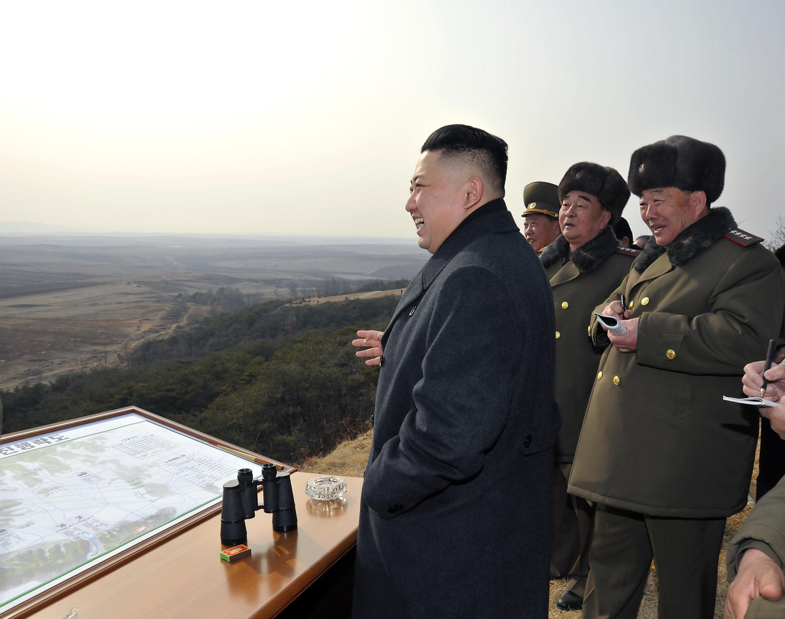 "This undated photo released by North Korea's official Korean Central News Agency (KCNA) via the Korean News Service (KNS) shows North Korean leader Kim Jong-Un (R) inspecting an artillery firing drill of the Korean People's Army.   Kim Jong-Un oversaw a live-fire artillery drill aimed at simulating an ""actual war"", state media said, a day after South Korea swore in its first female president.?Photo by AFP"