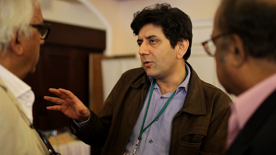 Ali Dayan Hasan speaks to people after the session on human rights. - Photo by Sara Farqui/Dawn.com