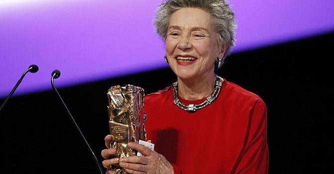 """French actress Emmanuelle Riva holds her trophy after receiving the Best Actress award for Austrian director Michael Haneke's film """"Amour"""" (Love) during the 38th Cesar Awards ceremony on February 22, 2013 at the Chatelet theatre in Paris. — AFP Photo"""