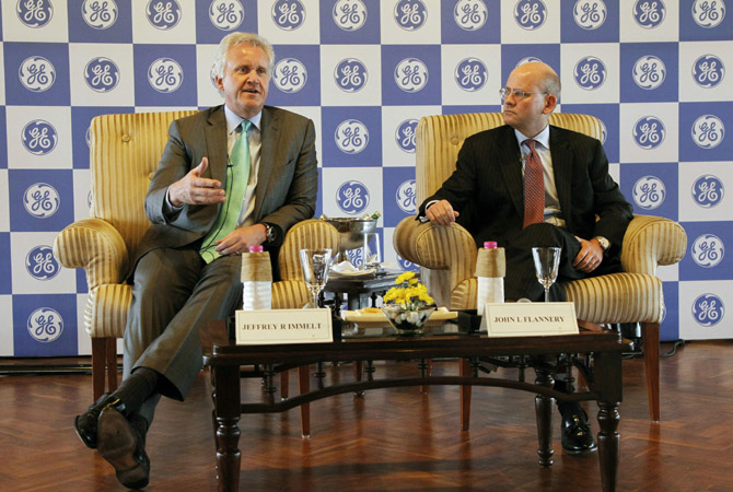 "General Electric Co Chief Executive Jeff Immelt speaks with the media as John Flannery, head of GE in India, watches in New Delhi. General Electric Co expects revenues from the company's Indian business to grow between 15 and 20 per cent on a ""sustainable basis"", Immelt said on Friday. GE, which installed India's first hydro power plant in 1902, has Indian revenues of about $2.8 billion and employs about 15,000 people there."