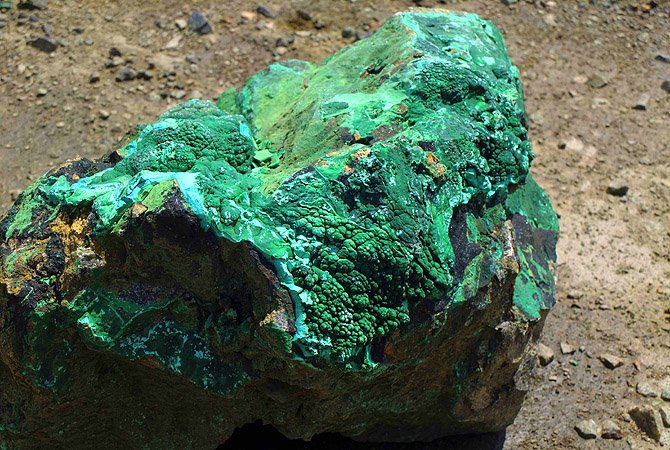 A piece of malachite, a copper ore, is seen at the bottom of Congolese state mining company Gecamines' Kamfundwa open pit copper mine. At its peak, Gecamines was almost a state within a state. It directly employed more than 30,000 people and ran schools, hospitals, flour mills and vast swathes of arable land, much of which it still maintains, further draining its stretched finances. Its roots are in the mining company set up at the turn of the last century by statesman Cecil Rhodes and Belgian King Leopold II, whic