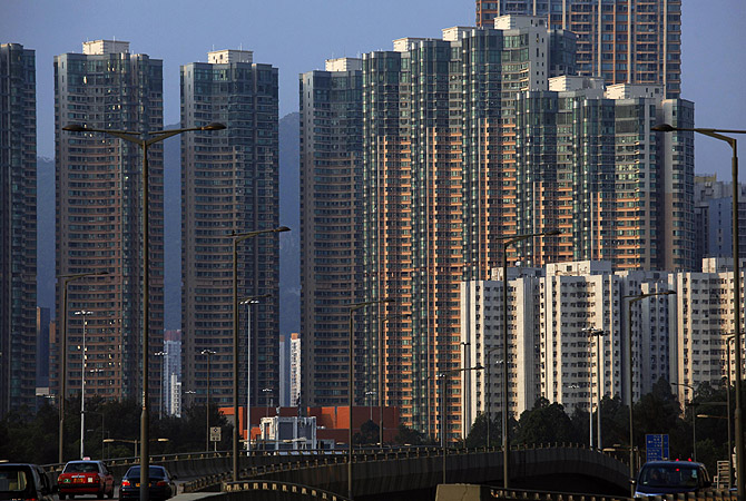Light shines on a column of highrise residential towers during sunset in Hong Kong. Hong Kong will impose new measures, including raising buyers' stamp duties, to cool its overheated property sector, which has some of the world's most expensive apartments, officials said on Friday.