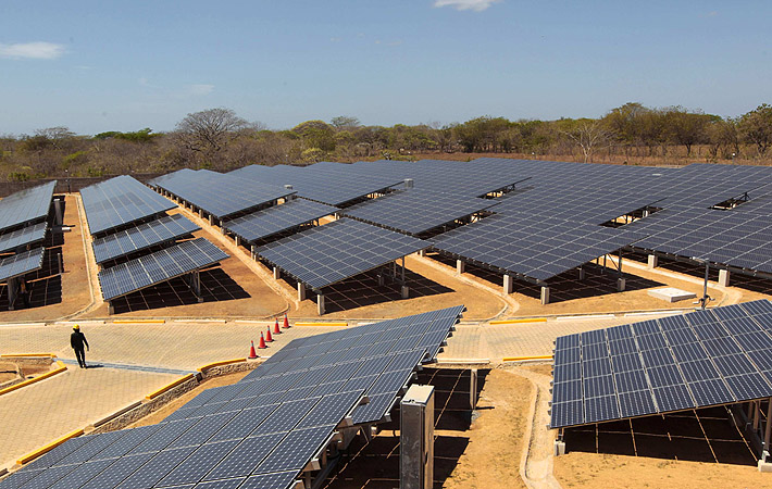 A visitor walk through solar panels donated by Japan's government at a solar plant in Diriamba. According to the facility, built at a cost of $11.9 million, Japan's government donated the 5,880 solar panels which will generate 1.38 Mw, enough to power 1,100 homes.