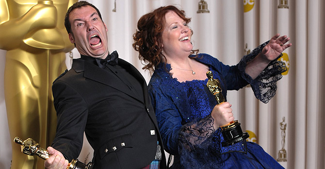 """** EMBARGOED AT THE REQUEST OF THE ACADEMY OF MOTION PICTURE ARTS & SCIENCES FOR USE UPON CONCLUSION OF THE ACADEMY AWARDS TELECAST ** Directors Mark Andrews, left, and Brenda Chapmanpose with their award for best animated feature film for """"Brave"""" during  at the Oscars at the Dolby Theatre on Sunday Feb. 24, 2013, in Los Angeles. (Photo by John Shearer/Invision/AP)"""