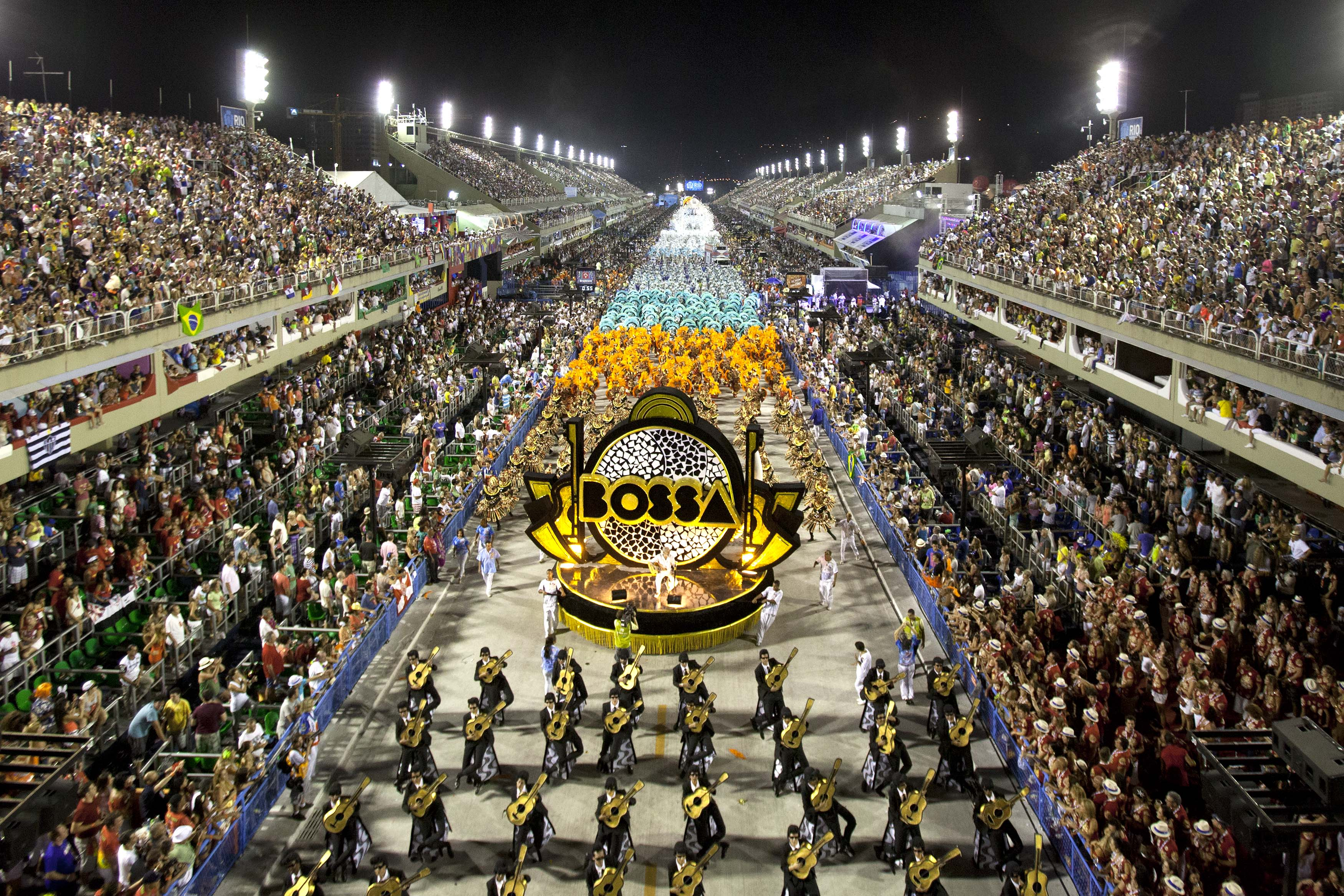 Performers from the Uniao da Ilha do Governador school parade during carnival celebrations at the Sambadrome in Rio de Janeiro, Brazil, early Monday, Feb. 11, 2013. (AP Photo/Felipe Dana)