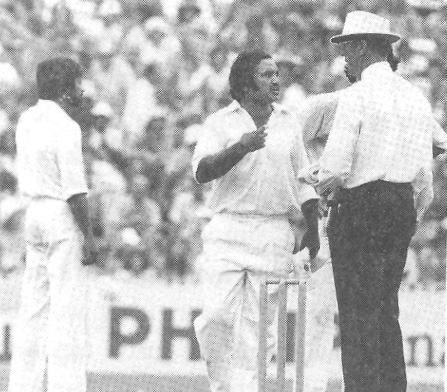 Mushtaq arguing with the umpire. Also seen is substitute fielder, Wasim Raja, and a furious Imran Khan (behind the umpire).