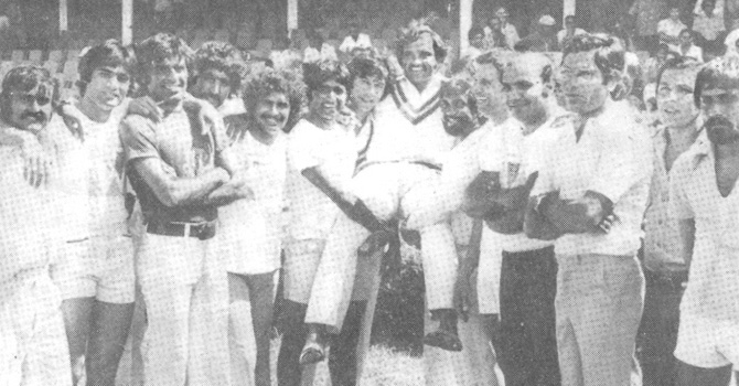 Mushtaq lifted on the shoulders by his team mates soon after Pakistan squared the series at the Port of Spain. (From Left): Iqbal Qasim, Mohsin Khan, Haroon Rashid, Sarfraz Nawaz, Wasim Bari, Javed Miandad, Imran Khan, Mushtaq Muhammad, Sadiq Muhammad, Asif Iqbal, Intikhab Alam, Zaheer Abbas, Saleem Altaf and Wasim Raja.